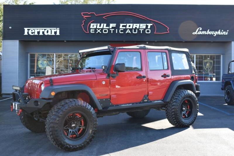 2014 Jeep Wrangler Unlimited for sale at Gulf Coast Exotic Auto in Biloxi MS