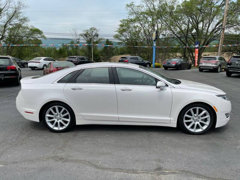 2015 Lincoln MKZ for sale at MAGNUM MOTORS in Reedsville PA