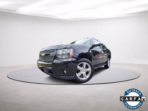 2013 Chevrolet Avalanche for sale at Carma Auto Group in Duluth GA