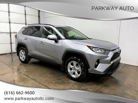 2019 Toyota RAV4 for sale at PARKWAY AUTO in Hudsonville MI