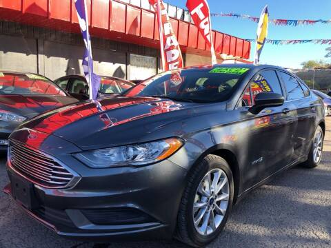 2017 Ford Fusion Hybrid for sale at Duke City Auto LLC in Gallup NM