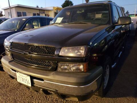 2004 Chevrolet Avalanche for sale at MCHENRY AUTO SALES in Modesto CA