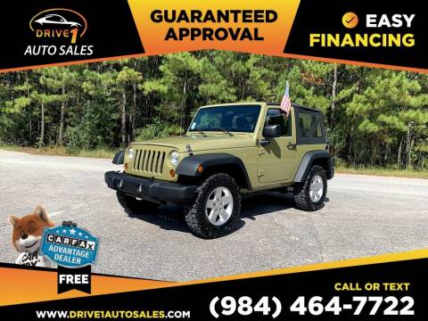 2013 Jeep Wrangler for sale at Drive 1 Auto Sales in Wake Forest NC
