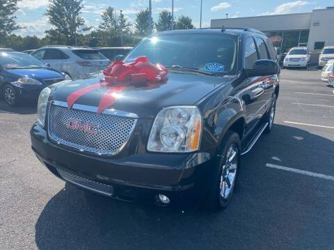 2011 GMC Yukon for sale at Charlotte Auto Group, Inc in Monroe NC