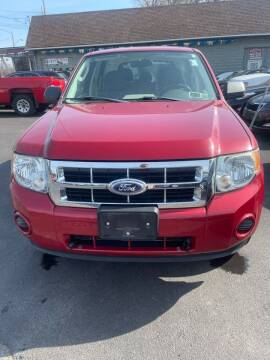 2010 Ford Escape for sale at Right Choice Automotive in Rochester NY