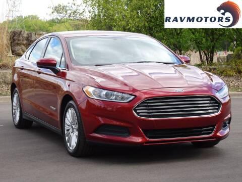 2014 Ford Fusion Hybrid for sale at RAVMOTORS in Burnsville MN