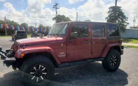 2012 Jeep Wrangler Unlimited for sale at Rons Auto Sales in Stockdale TX