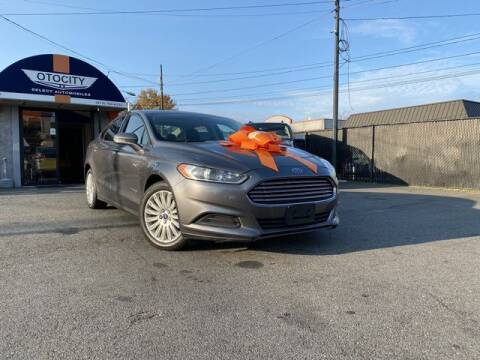 2014 Ford Fusion Hybrid for sale at OTOCITY in Totowa NJ