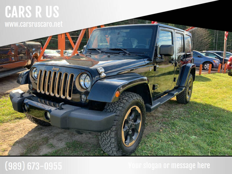2014 Jeep Wrangler Unlimited for sale at CARS R US in Caro MI