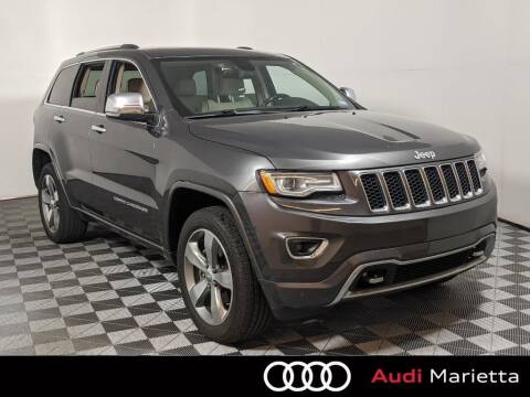 2015 Jeep Grand Cherokee for sale at CU Carfinders in Norcross GA
