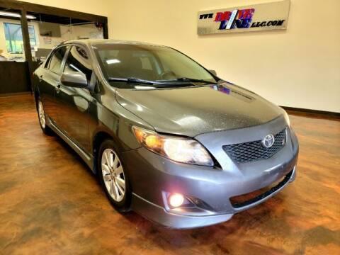 2010 Toyota Corolla for sale at Driveline LLC in Jacksonville FL