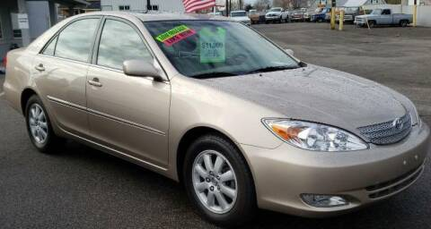 2004 Toyota Camry for sale at Artistic Auto Group, LLC in Kennewick WA