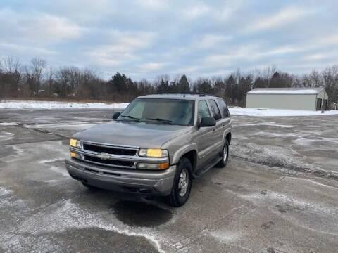 2002 Chevrolet Tahoe for sale at Caruzin Motors in Flint MI