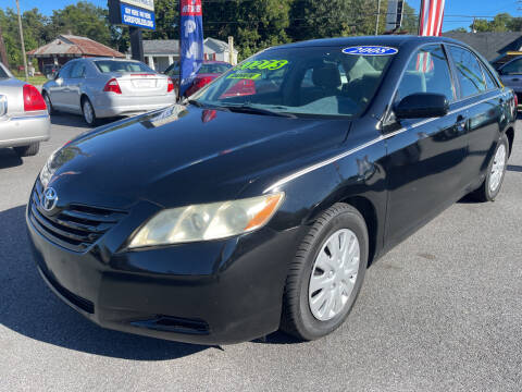 2008 Toyota Camry for sale at Cars for Less in Phenix City AL