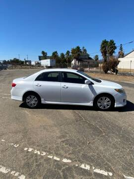 2009 Toyota Corolla for sale at E and M Auto Sales in Bloomington CA