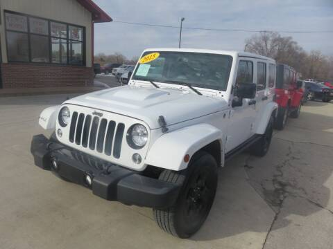 2015 Jeep Wrangler Unlimited for sale at Azteca Auto Sales LLC in Des Moines IA