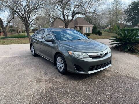 2014 Toyota Camry for sale at CARWIN MOTORS in Katy TX