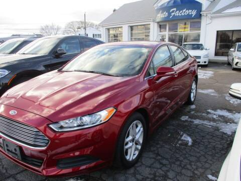 2014 Ford Fusion for sale at AUTO FACTORY INC in East Providence RI