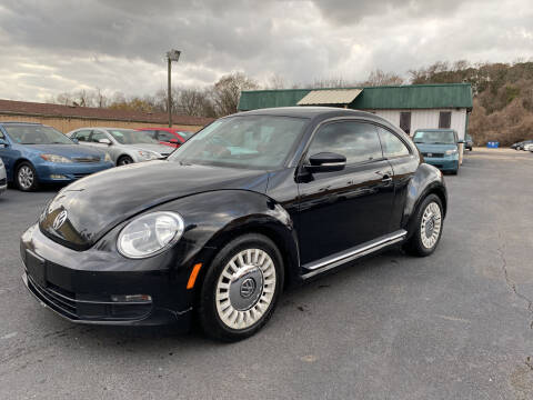 2014 Volkswagen Beetle for sale at ASTRO MOTORS in Houston TX