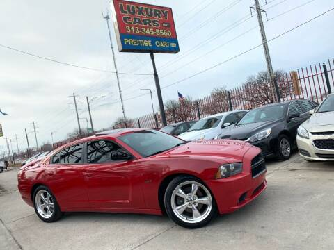 2013 Dodge Charger for sale at Dymix Used Autos & Luxury Cars Inc in Detroit MI