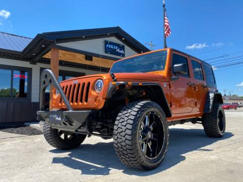 2011 Jeep Wrangler Unlimited for sale at Fesler Auto in Pendleton IN