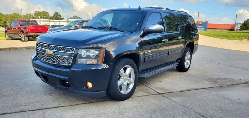 2013 Chevrolet Suburban for sale at WHOLESALE AUTO GROUP in Mobile AL
