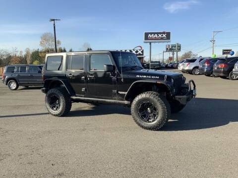 2013 Jeep Wrangler Unlimited for sale at Maxx Autos Plus in Puyallup WA