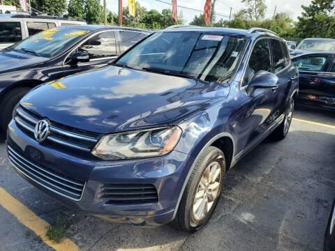 2013 Volkswagen Touareg for sale at America Auto Wholesale Inc in Miami FL