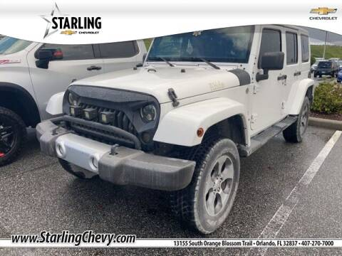 2013 Jeep Wrangler Unlimited for sale at Pedro @ Starling Chevrolet in Orlando FL