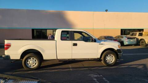 2014 Ford F-150 for sale at E and M Auto Sales in Bloomington CA