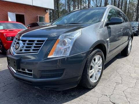 2013 Cadillac SRX for sale at Magic Motors Inc. in Snellville GA
