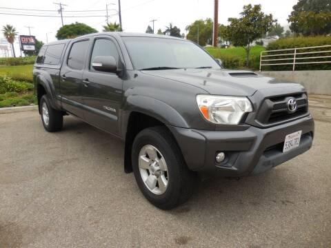 2014 Toyota Tacoma for sale at ARAX AUTO SALES in Tujunga CA