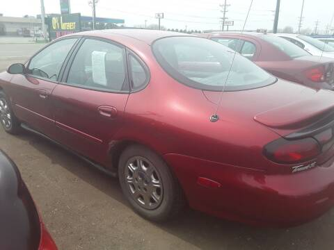 1998 Ford Taurus for sale at BARNES AUTO SALES in Mandan ND