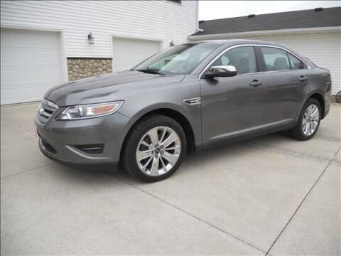 2011 Ford Taurus for sale at OLSON AUTO EXCHANGE LLC in Stoughton WI