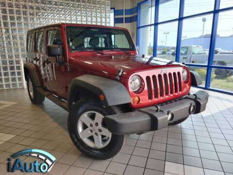 2011 Jeep Wrangler Unlimited for sale at iAuto in Cincinnati OH