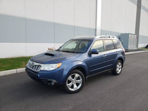 2012 Subaru Forester for sale at Positive Auto Sales, LLC in Hasbrouck Heights NJ