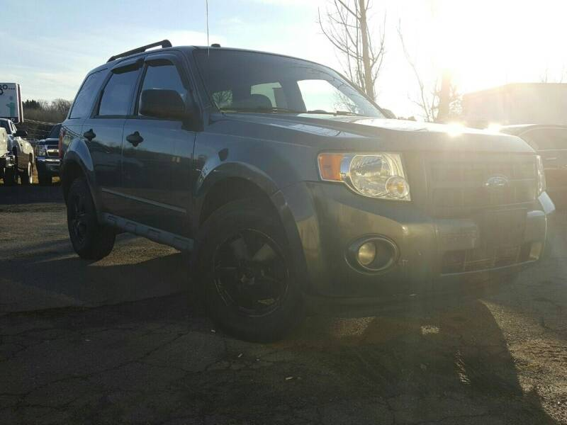 2009 Ford Escape for sale at GLOVECARS.COM LLC in Johnstown NY