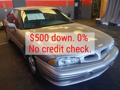 1999 Pontiac Bonneville for sale at D & J AUTO EXCHANGE in Columbus IN