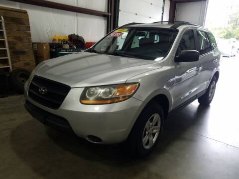 2009 Hyundai Santa Fe for sale at Hometown Automotive Service & Sales in Holliston MA