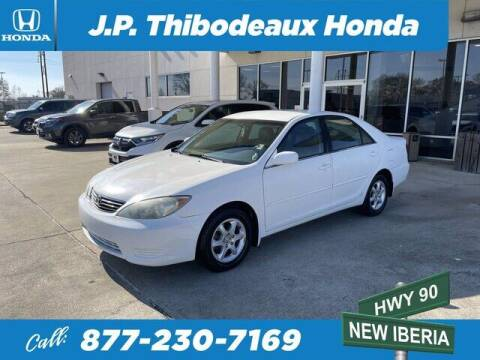 2005 Toyota Camry for sale at J P Thibodeaux Used Cars in New Iberia LA
