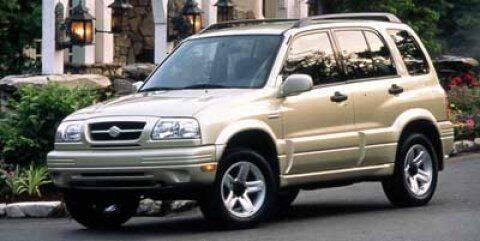 1999 Suzuki Grand Vitara for sale at WOODLAKE MOTORS in Conroe TX