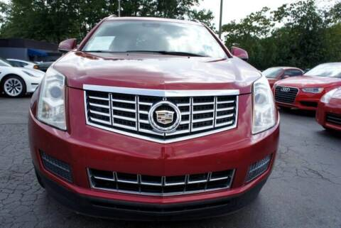 2014 Cadillac SRX for sale at CU Carfinders in Norcross GA