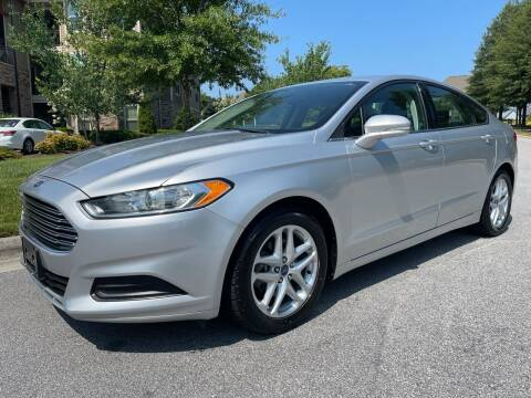 2013 Ford Fusion for sale at LA 12 Motors in Durham NC