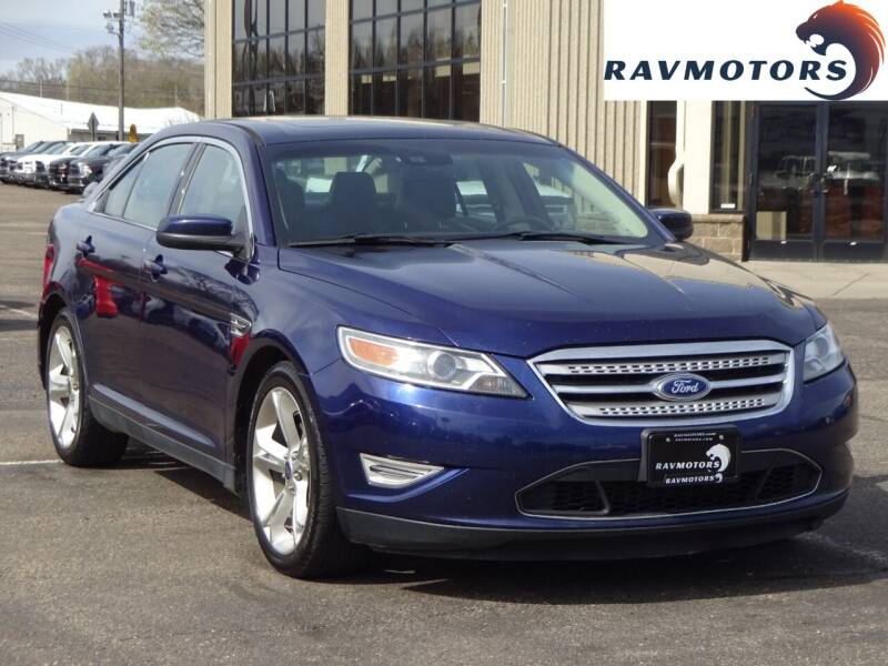 2011 Ford Taurus for sale at RAVMOTORS 2 in Crystal MN