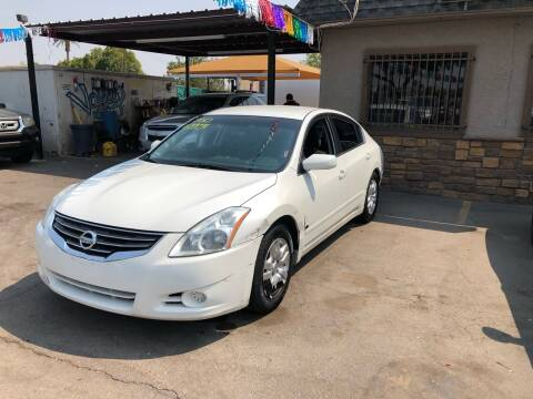 2012 Nissan Altima for sale at Valley Auto Center in Phoenix AZ
