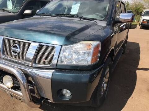 2007 Nissan Armada for sale at BARNES AUTO SALES in Mandan ND