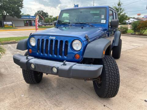 2009 Jeep Wrangler Unlimited for sale at Houston Auto Gallery in Katy TX