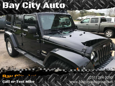 2008 Jeep Wrangler Unlimited for sale at Bay City Auto's in Mobile AL