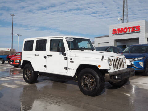 2016 Jeep Wrangler Unlimited for sale at SIMOTES MOTORS in Minooka IL