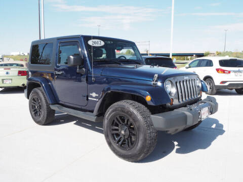 2012 Jeep Wrangler for sale at SIMOTES MOTORS in Minooka IL